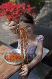 Girl is eating spaghetti. Seven year old girl is eating spaghetti outside Royalty Free Stock Photo