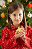 Girl Eating Star Shaped Cookie In Front Of Tree stock image
