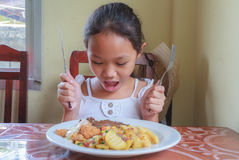 Girl eating Steak Royalty Free Stock Images