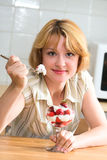 Girl eating strawberries Stock Photography