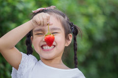 Girl eating strawberries Royalty Free Stock Photos