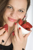 Girl eating strawberries Stock Photo