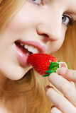 Girl eating strawberry Stock Photo