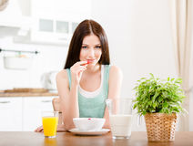 Girl eating strawberry with milk and citrus juice Stock Photo