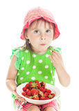 Girl eating a strawberry Stock Photo