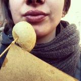 Girl eating street food Royalty Free Stock Image