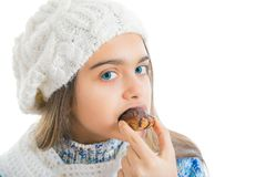 Girl Eating Sugary Donut. Stock Photo