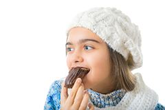 Girl Eating Sugary Donut. Royalty Free Stock Images