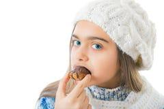 Girl Eating Sugary Donut. Royalty Free Stock Image