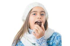 Girl Eating Sugary Donut. Royalty Free Stock Photo