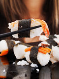 Girl eating sushi Royalty Free Stock Image
