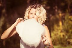 Girl eating sweet cotton candy Royalty Free Stock Photo