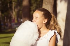 Girl eating sweet cotton candy Royalty Free Stock Images