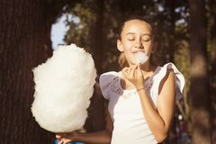 Girl eating sweet cotton candy Royalty Free Stock Image