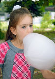 Girl eating sweet cotton wool Royalty Free Stock Photo