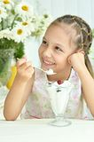Girl eating sweet  dessert with berries Stock Photos