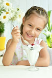 Girl eating sweet  dessert with berries Royalty Free Stock Photo