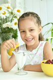 Girl eating sweet  dessert with berries Royalty Free Stock Photography