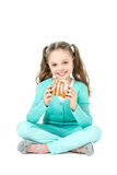 Girl eating sweet rolls, facial expression Royalty Free Stock Image