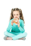 Girl eating sweet rolls, facial expression Stock Photo
