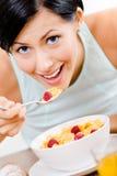 Girl eating tasty breakfast Royalty Free Stock Photography