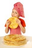 Girl eating tasty pancake Royalty Free Stock Photography