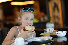 Girl eating toast Royalty Free Stock Photos