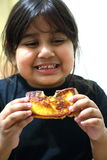 Girl Eating Toast Royalty Free Stock Photography