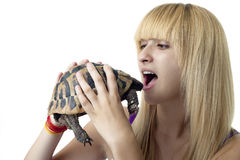 Girl Eating a Turtle Royalty Free Stock Photo