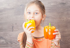 Girl eating vegetables Stock Photo