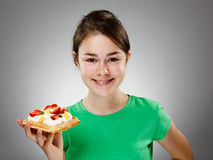 Girl eating waffle Stock Photos