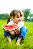 Girl eating water-melon Stock Photos