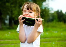 Girl eating water-melon Stock Photography