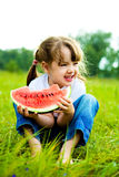 Girl eating water-melon Royalty Free Stock Photos