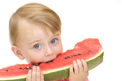 Girl eating watermelon Stock Photography
