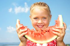 Girl eating watermelon Stock Photos
