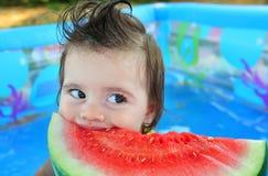 Girl eating watermelon Stock Photos