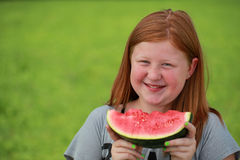 Girl eating a watermelon Royalty Free Stock Photography