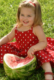 Girl eating watermelon Stock Photo