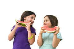 Girl eating Watermelon. Isolated on white background Royalty Free Stock Image