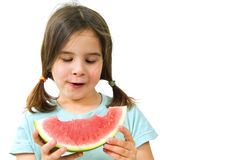 Girl eating Watermelon. Isolated on white background Stock Image