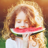Girl eating watermelon enjoying closing her eyes. Diet, vitamins, healthy food concept Royalty Free Stock Image