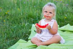 Girl eating watermelon Stock Photo