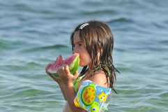 Girl eating watermelon on seashore. Food,fruits Stock Photo