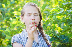 Girl eating wild strawberries Royalty Free Stock Images