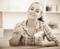 Girl eating yoghurt Stock Photo