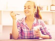 Girl eating yoghurt Stock Photography