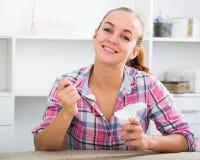 Girl eating yoghurt Royalty Free Stock Images