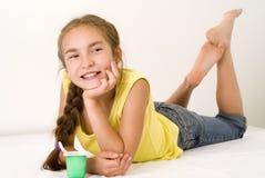 Girl eating yoghurt VII. The nice girl eating yoghurt, isolated Stock Photo