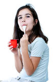Girl eating yogurt Stock Image
